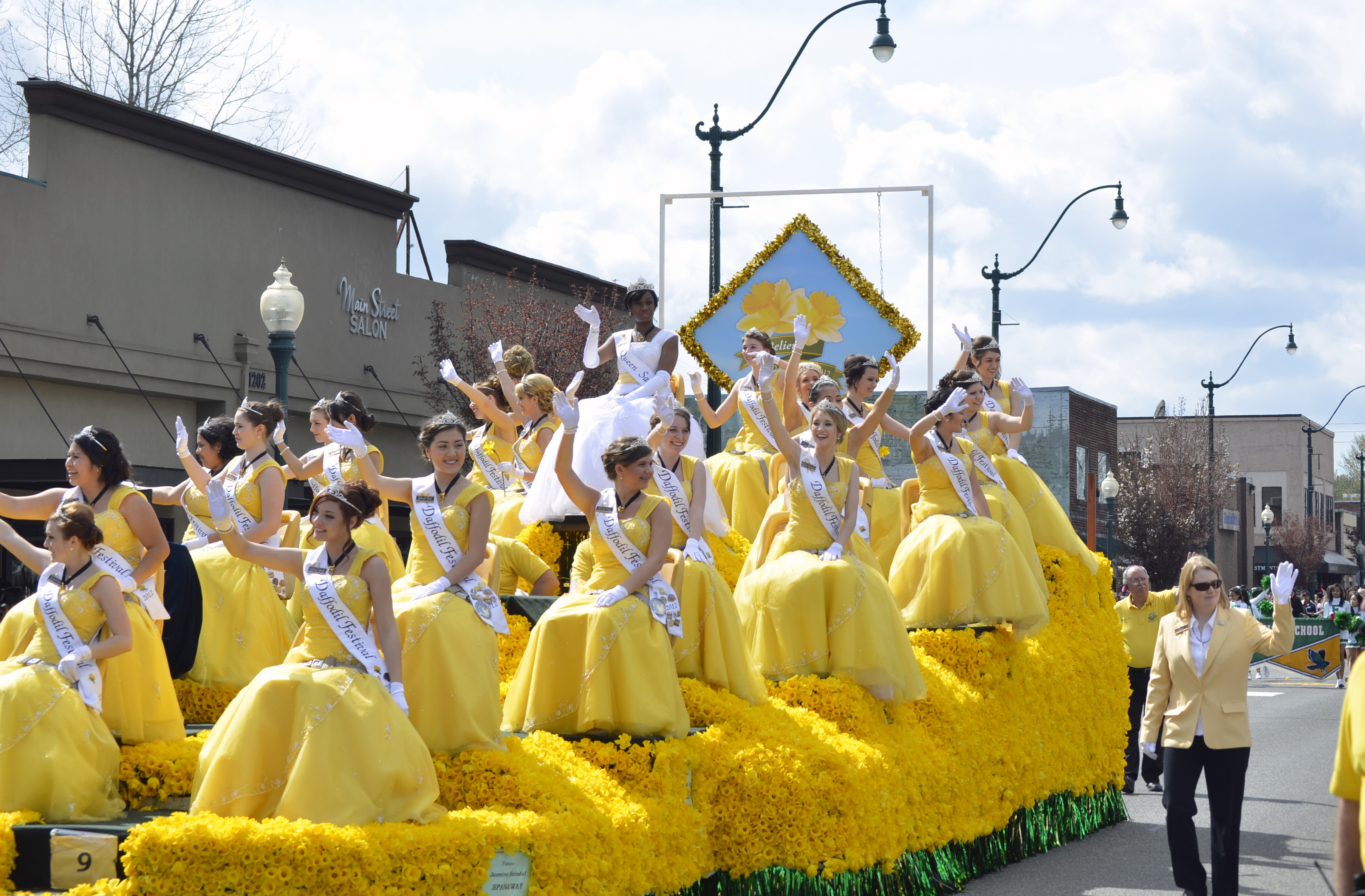 Sumner Daffodil Parade - LaRose (7):  The Queen and her Royal Court ride on the Queen's float.  The Daffodil princesses are official Ambassadors of the Festival. The twenty four young women participating in the Royalty program have each been selected by their schools and communities to represent the Daffodil Festival and Pierce County as the Festival travels throughout the Pacific Northwest. Mindi LaRose/Special to the Herald